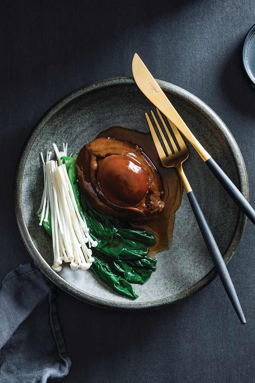 Braised abalone with mushrooms and greens